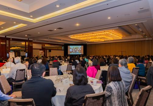 Main Ballroom with Participants Watching a Video