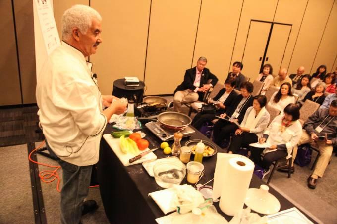 Chef Simon Elmaleh cooking Mediterranean Food