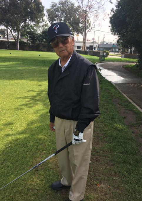 Yosh playing golf