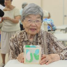 Older woman holding her homemade lantern