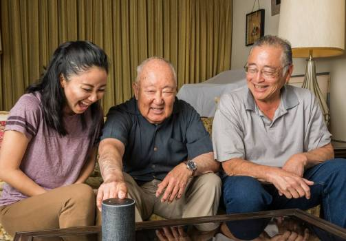 Older adult using smarthome tech with other family members