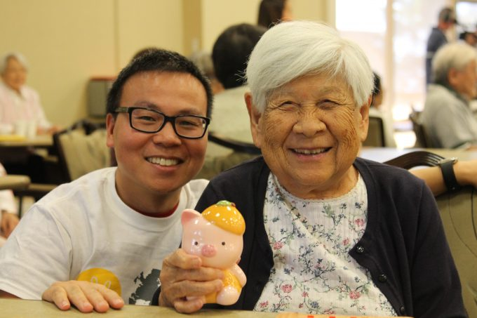 Adult man with elderly adult woman