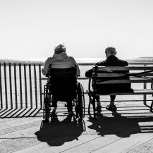 older adults at a bench