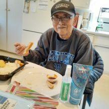 older adult eating lunch
